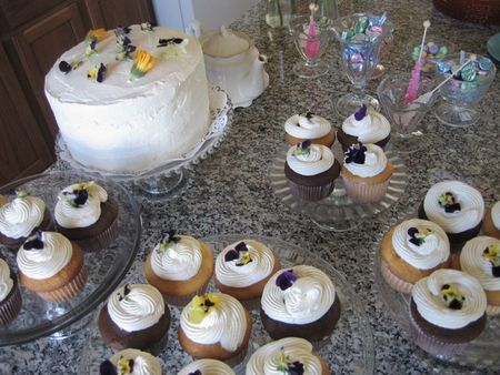 cakes and cupcakes with edible flowers for baby shower