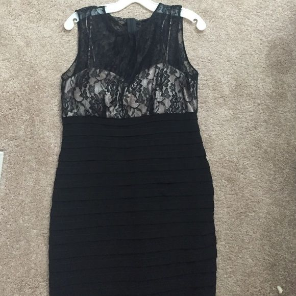Black body-con dress with lace detail at the top Black body-con dress with lace detail at the top,size 14 fits true to size Dresses Asymmetrical