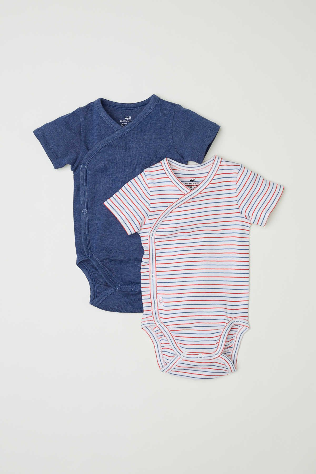 Short-sleeved wrapover bodysuits in soft organic cotton jersey with snap  fasteners at side and at gusset. 630a1cce335