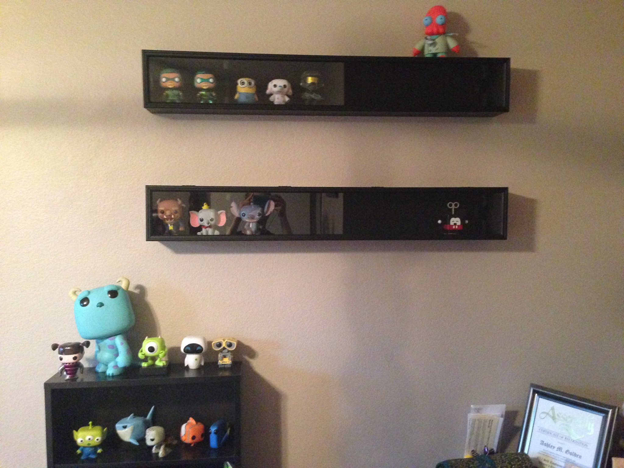 use baseball bat display cases from hobby stores to display your