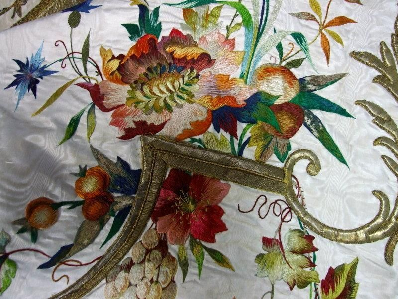 watered silk ground beautifully hand embroidered with coloured silks. Opulent gold bullion work throughout. Dating from 19th century