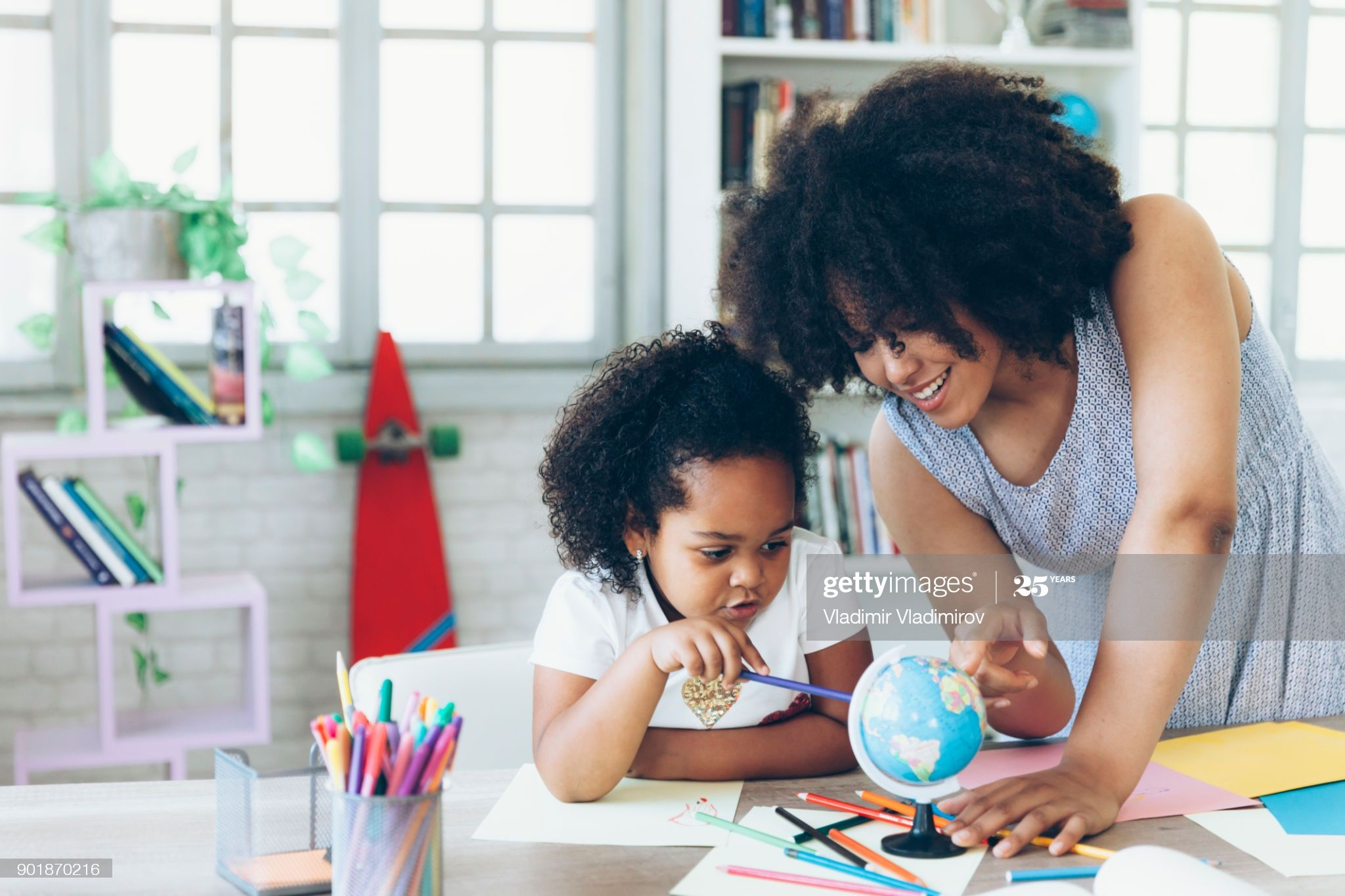 Mother And Daughter Get To Know The World Using A Globe