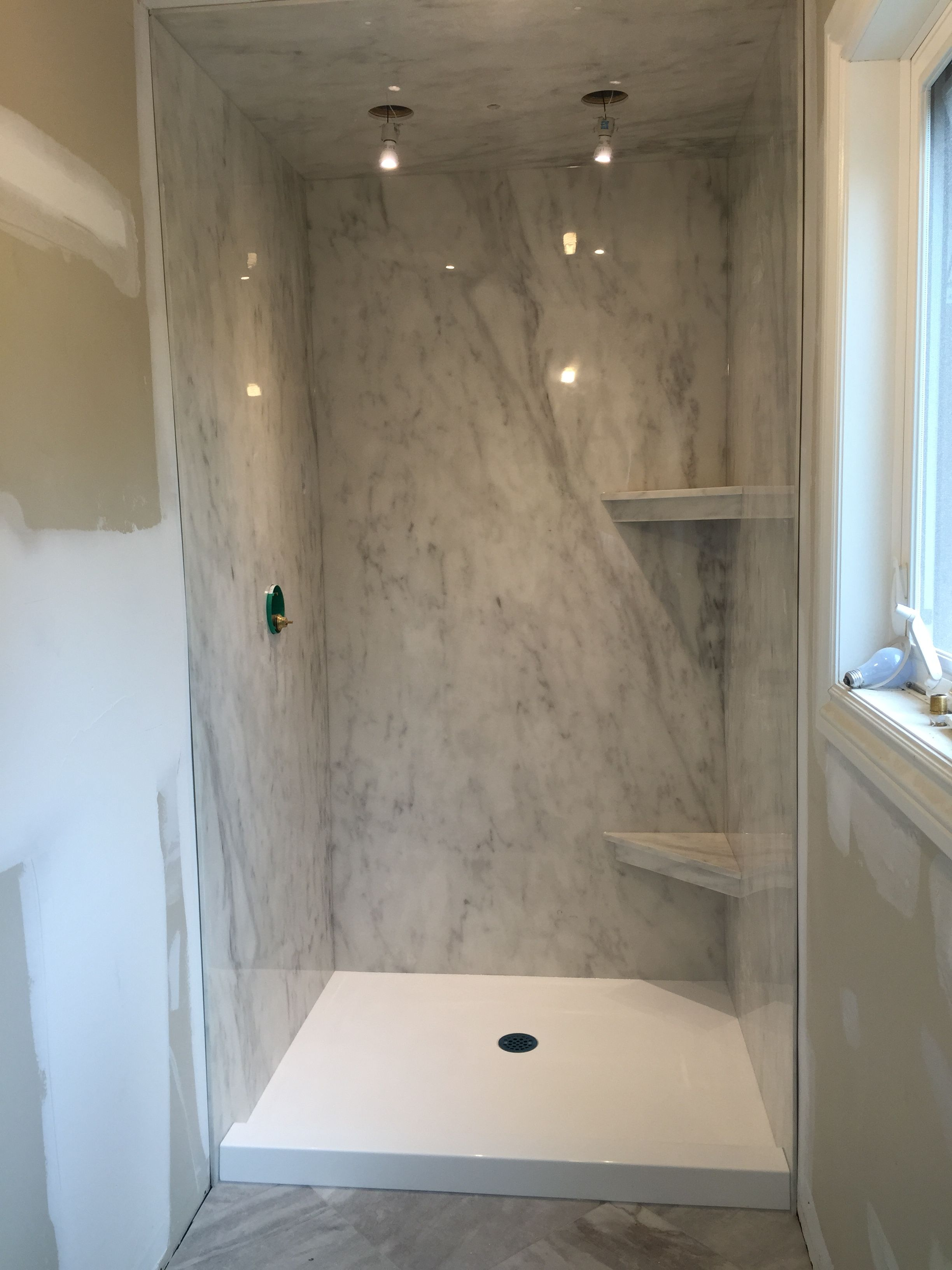 A Subtle Grey Marble Ite Shower Paired With A Bright White Cultured Marble  Base