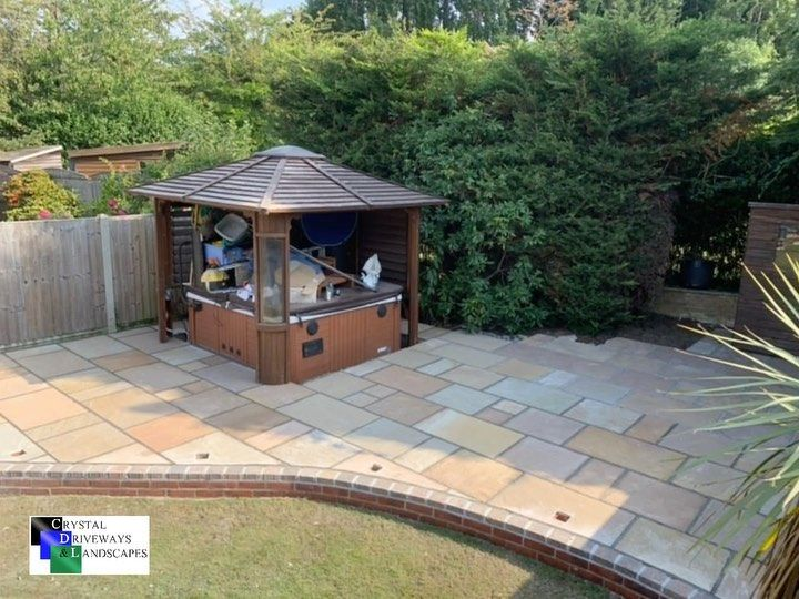 This weeks project has been a sandstone patio installation in Emerson Park, Essex Electrics will be going in to the rear patio next week adding extra lighting for the cold dark nights sitting in the hot tub!! #crystaldriveways #hottub #essexgarden #outdoors #september #autumn #landscape #driveways #essexgarden #homedecor #homesweethome