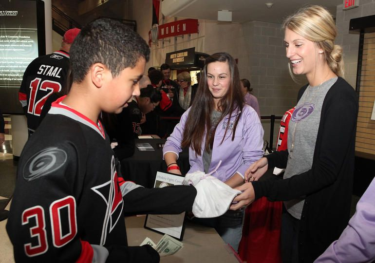 f20d1467a Wives of the  Canes (including Tanya Staal) sell autographed hats to raise  money for Hockey Fights Cancer  Nov 3