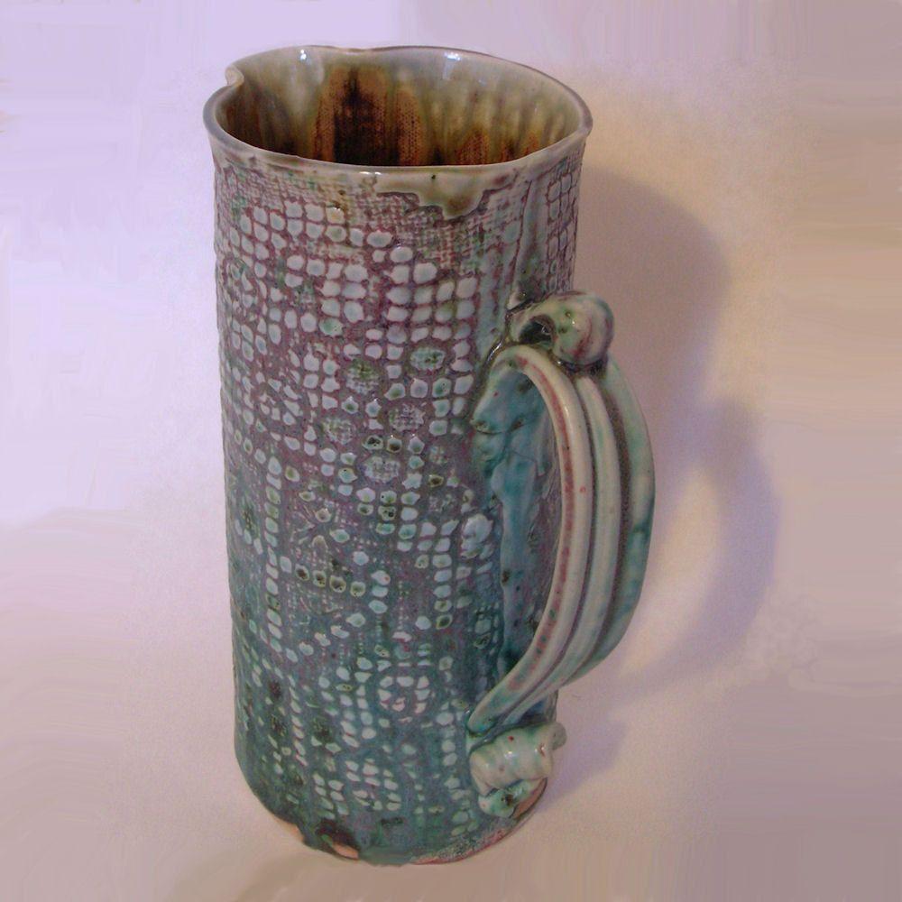 Porcelain Pottery Pitcher, Hand built, Textured, Turquoise. $65.00, via Etsy.