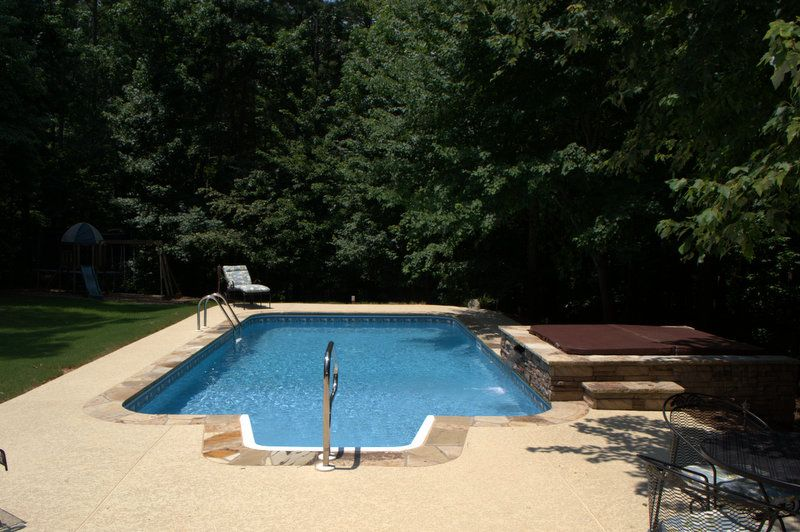 Design Your Dream Backyard Living Space With Brown S Pools Spas Of Dallas Georgia Www Brownspools Com Phot Backyard Vacation Pool Swimming Pool Construction
