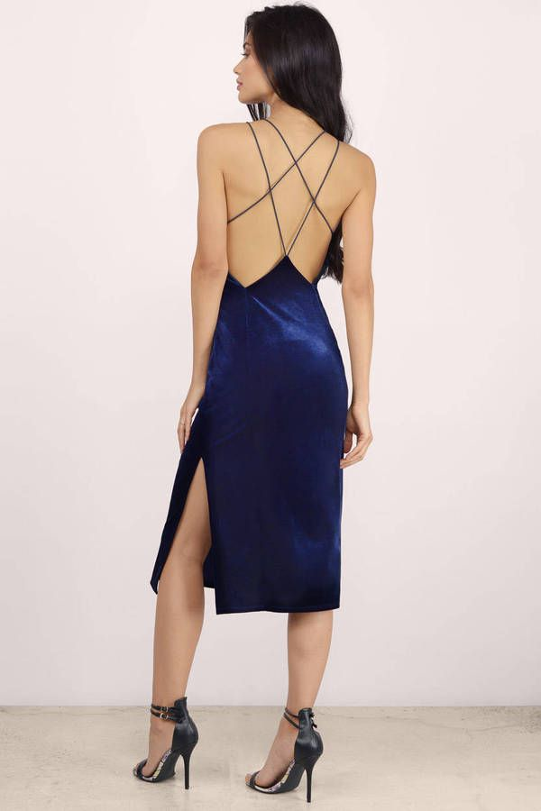Blue, sleek midi bodycon with extra cross straps at front and back. Side slits for a sexy appeal. Wear with strappy heels to complete the look this holiday season!