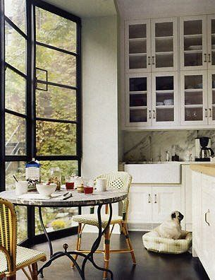 Breakfast nook. Steel windows. Black. White. Natural woven chairs.