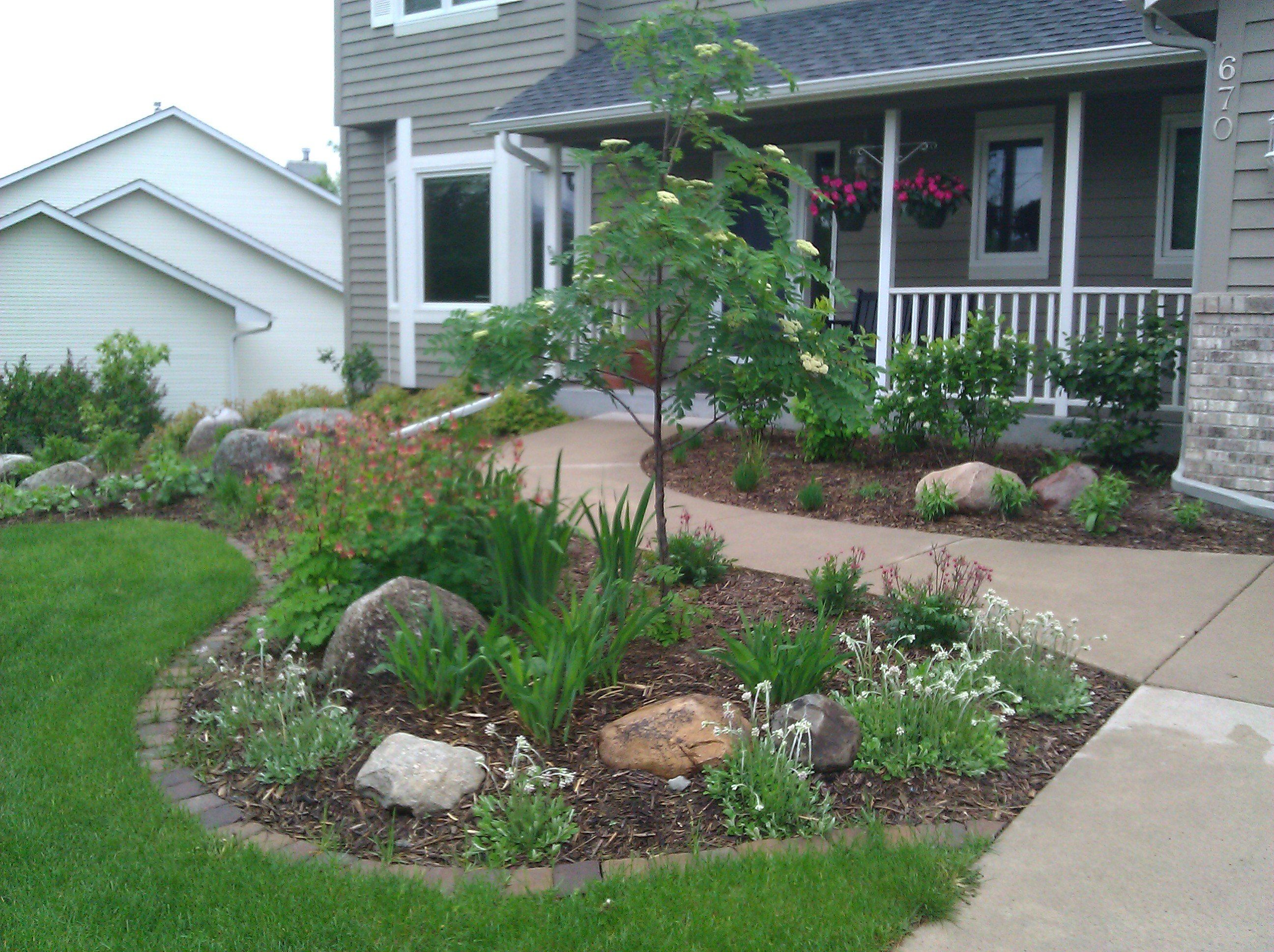 garden and patio small front yard landscaping house design with various plants flowers trees concrete walkway rocks and green grass around house ideas - Flower Garden Ideas Minnesota