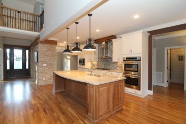 Hickory Kitchen Island Edging Tiles For Cabinets With Large Black Round Pendant Lights White Wall Double Ovens Gas Range