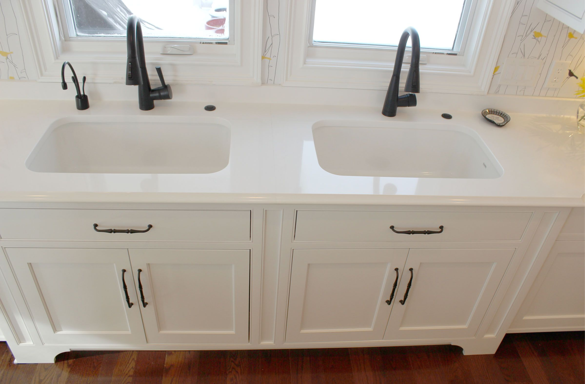 Two Franke Fireclay Undermount sinks with Delta Brizo Venuto in ...