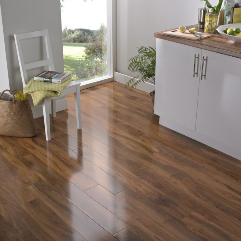 Add The BevelLOC Walnut Effect Laminate Flooring To Your Room For A Warm And Sparkling