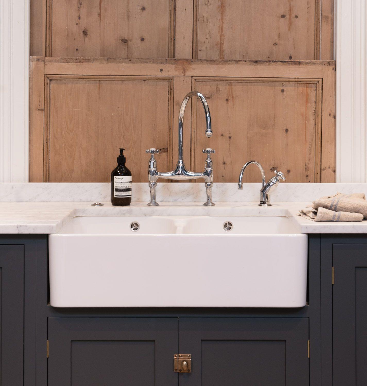 beautiful butler sink, honed carrara marble worktops and 'flint