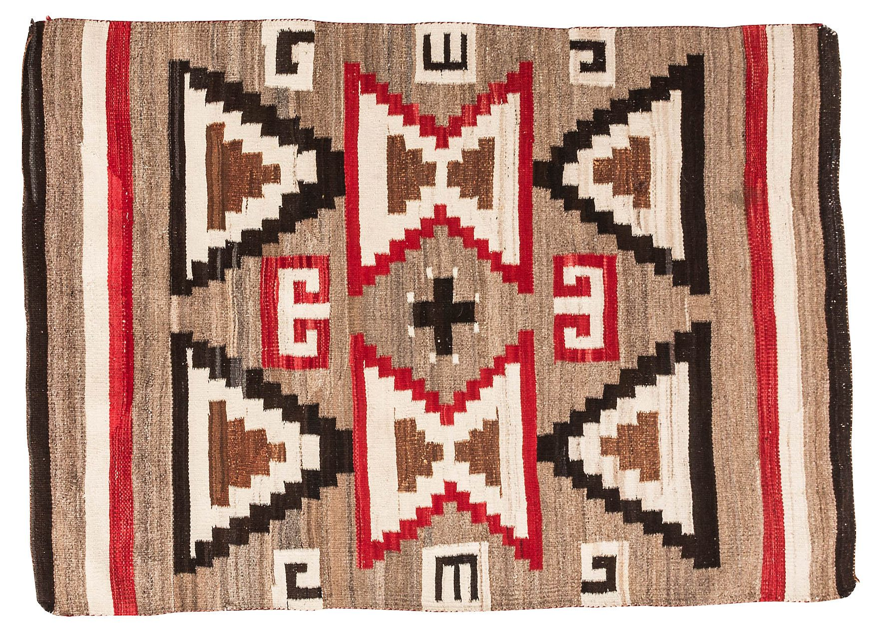 Navajo-style rug designed with triangles, hourglass shapes, and a small black cross in the middle. Circa 1930.