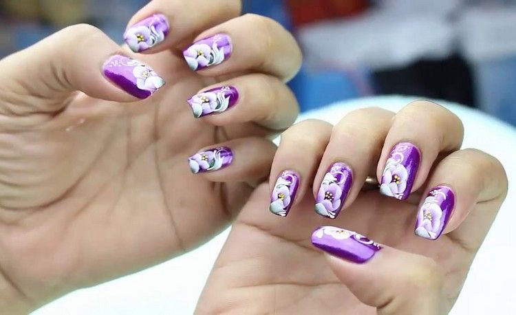 How to paint a flower on your nail with flower nail art designs nails are to be done with great care especially when you are doing yourself you can paint a flower on your nail by different methods and types solutioingenieria Choice Image