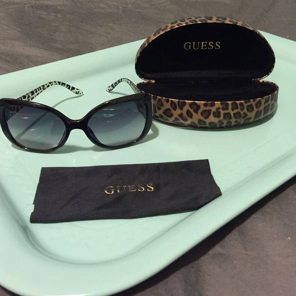 5f4556188a1a9 Guess animal print sunglasses Guess sunglasses with black face and animal  print arms. Comes with case and cleaning cloth. Guess Accessories Sunglasses