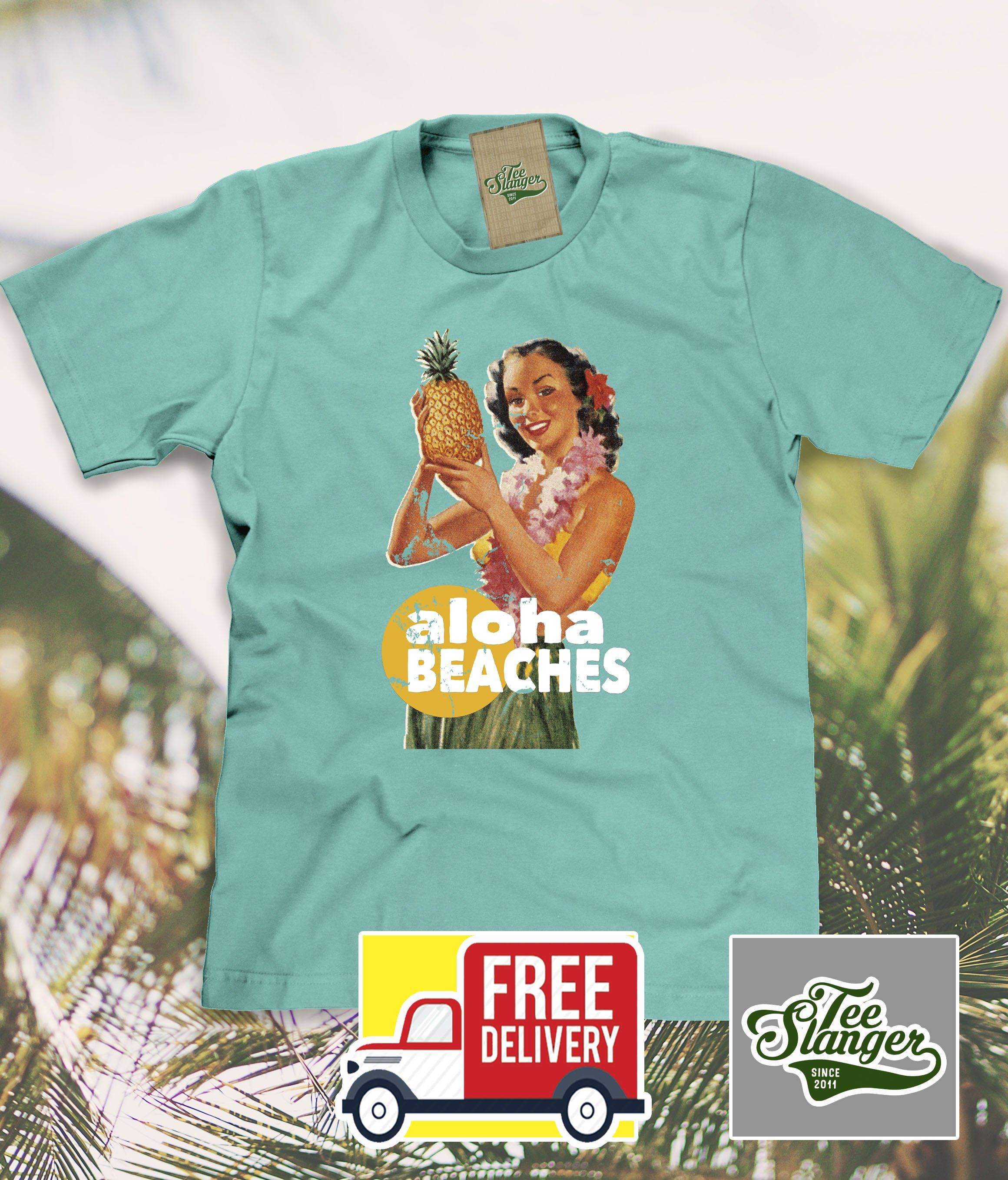 de04de77 Say Aloha Beaches and goodbye winter with this beachy Hawaii inspired tee  in mint green or heather grey. Available in unisex t-shirt or tank top.