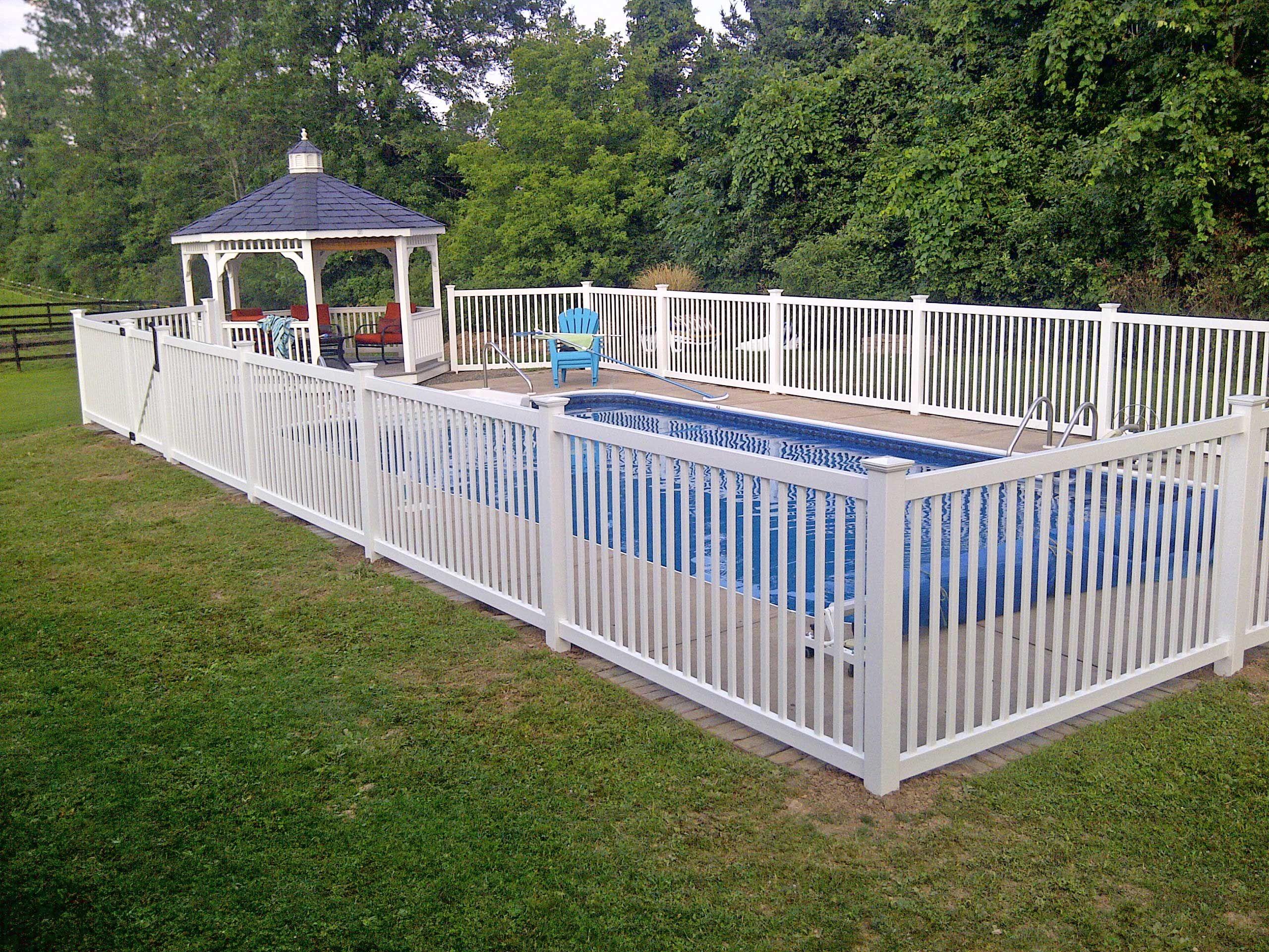 Vinyl Cayuga Yard Fence Installed Around An Inground Pool In