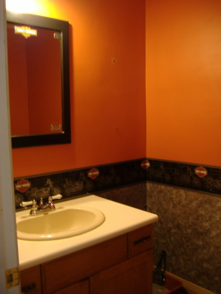 Bathrooms exquisite orange painted wall contemporary for Orange and brown bathroom ideas