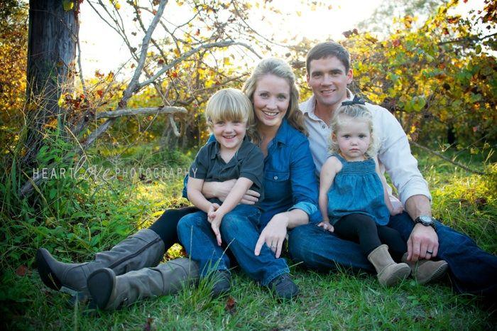 Natural family pose love vineyard backdrop
