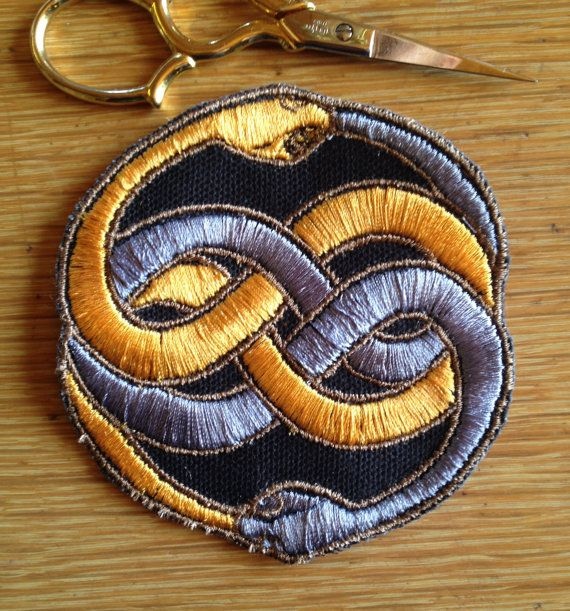 Based on the medalion from The NeverEnding Story - The Auryn patch: The Neverending Story by tenyelloweyes on Etsy