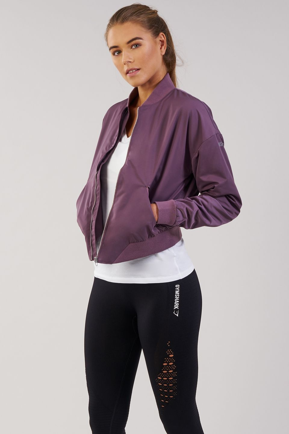 Accented With Ribbed Collar Cuffs And Hem Quality Comfort Is Guaranteed With The Gymshark Lo Bomber Jacket Comi Fitness Fashion Fashion Purple Bomber Jacket [ 1439 x 960 Pixel ]