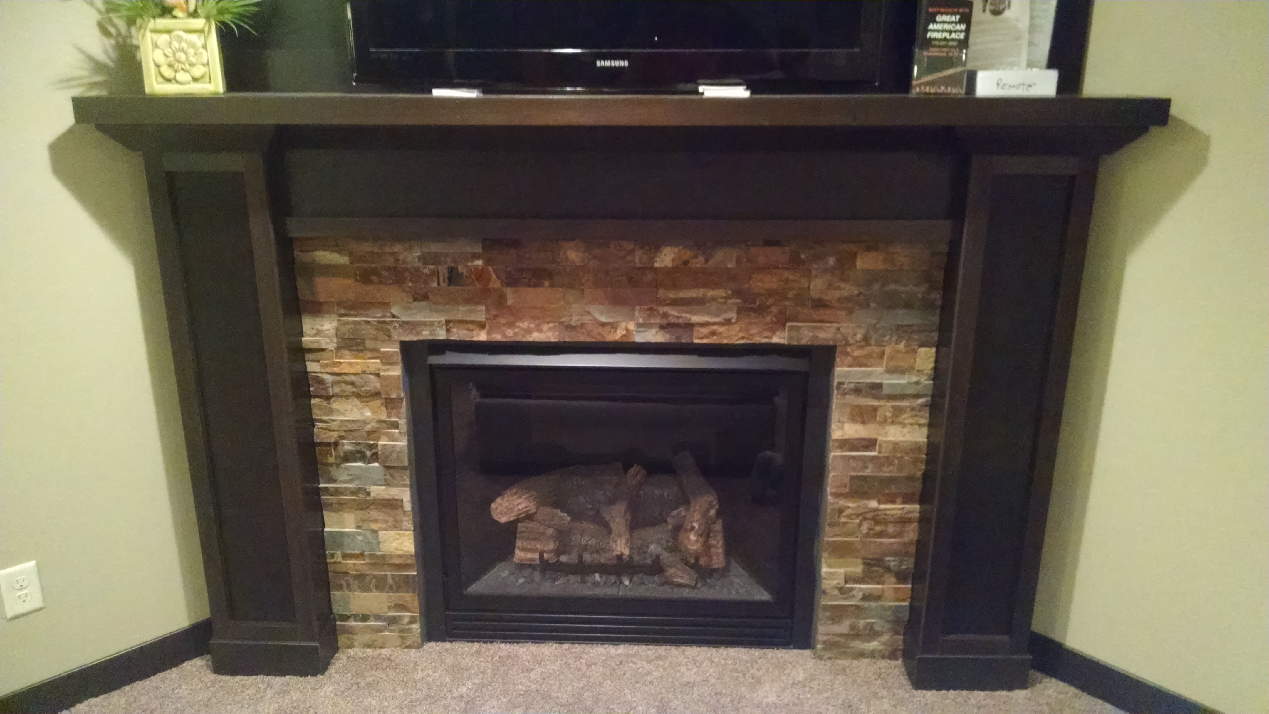 This fireplace is located in the basement rec room adding warmth for