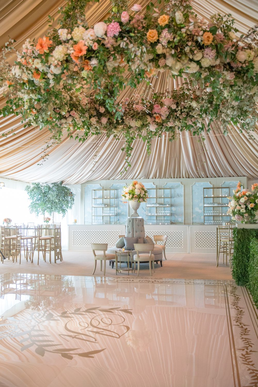 Epicly beautiful wedding tent, large floral chandelier, fabric lined ...