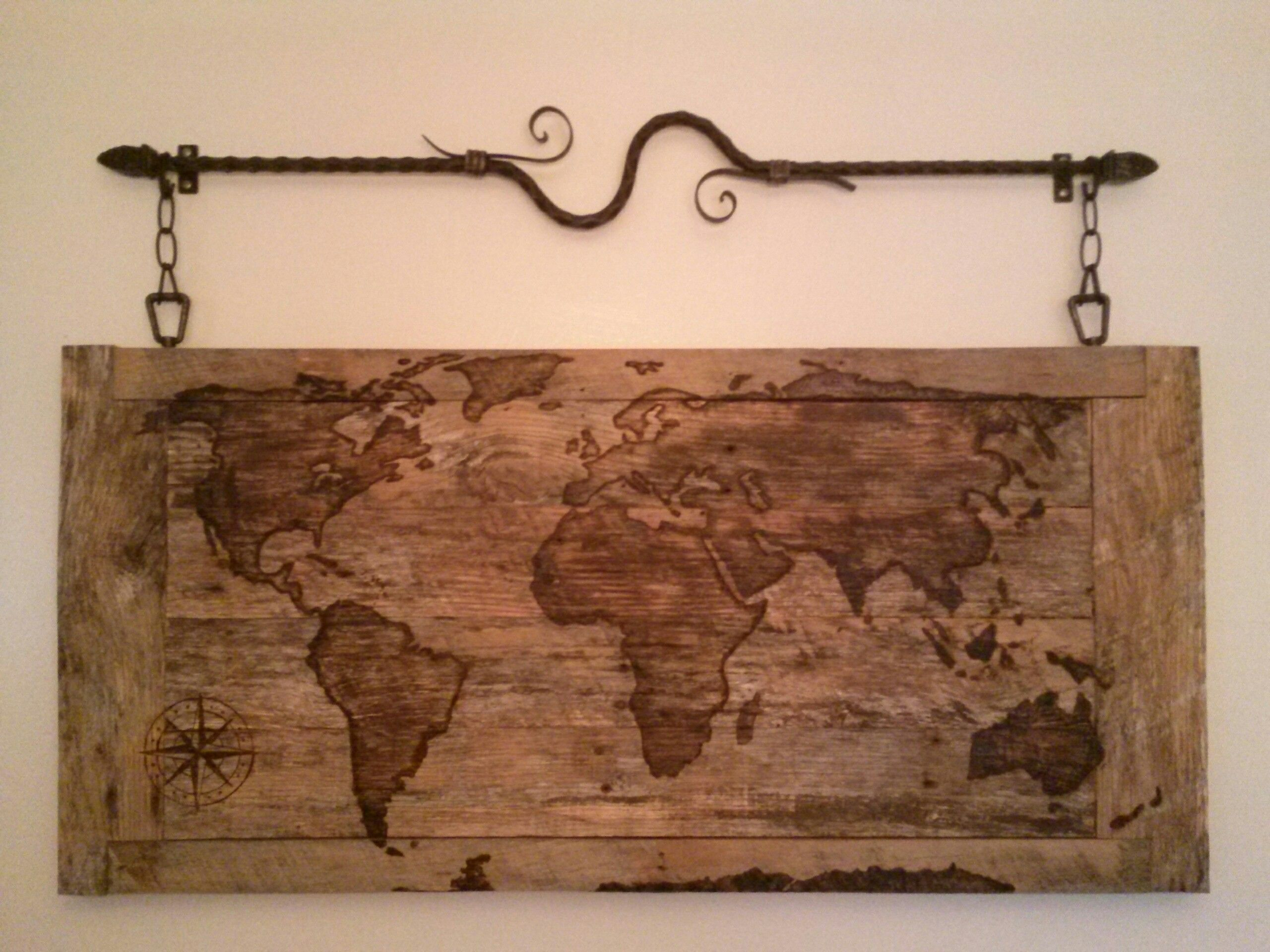 Wood burned world map on reclaimed wood