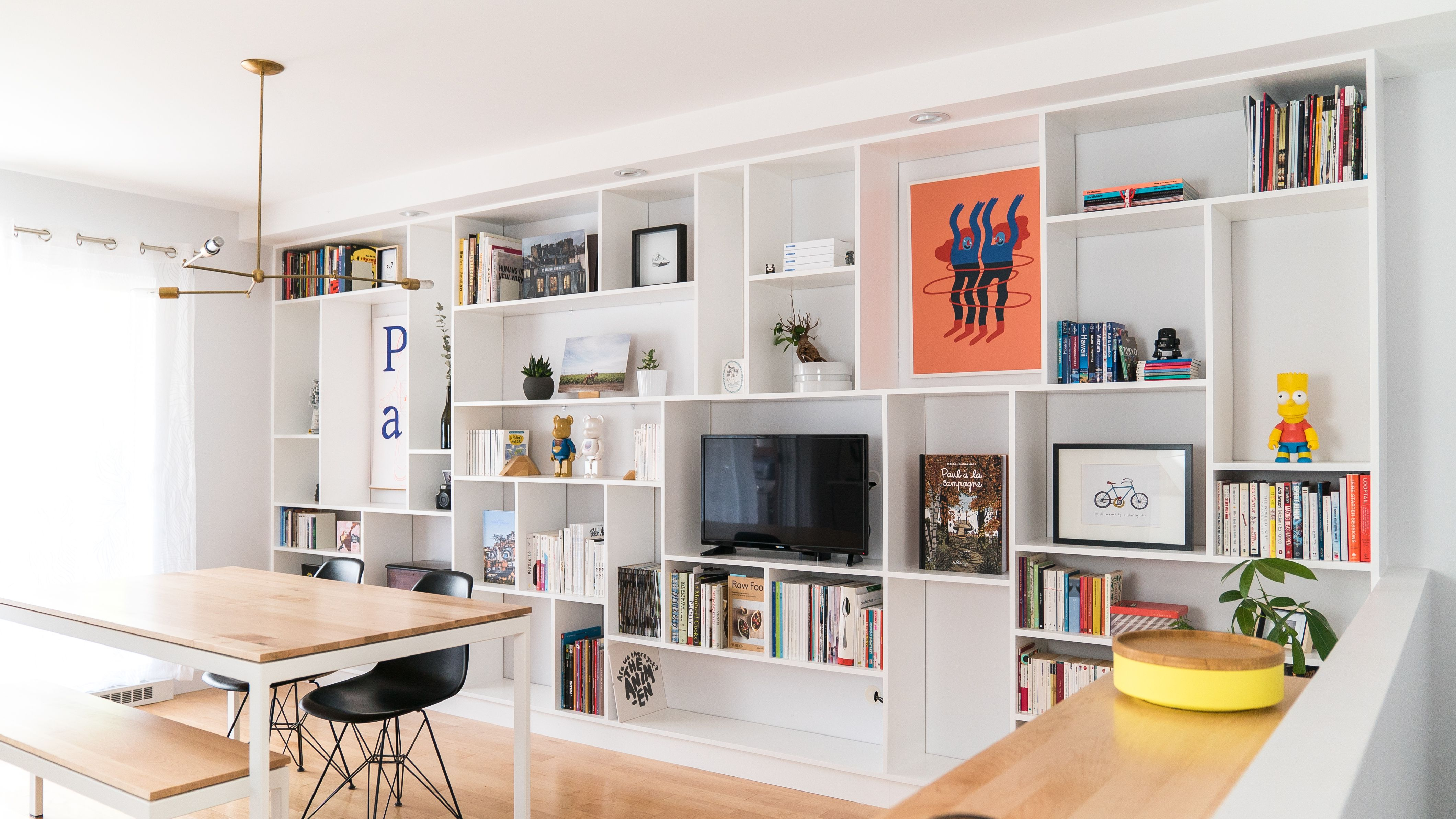 Before After A Big Blank Wall Gets A Very Functional Facelift Big Blank Wall Flat Interior Living Room Designs Living room bookshelf wall