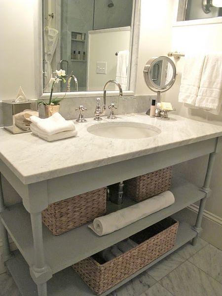 coastalbeach inspired bathroom open shelves marble