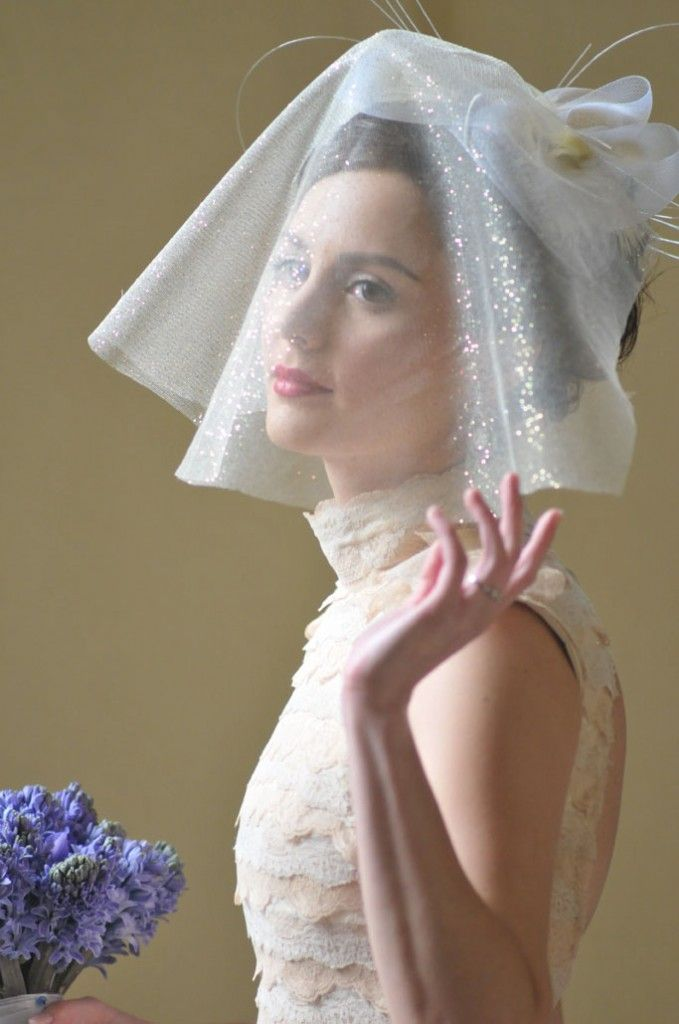 Lovely :) Like the layer-y effect of the top of her wedding gown ...