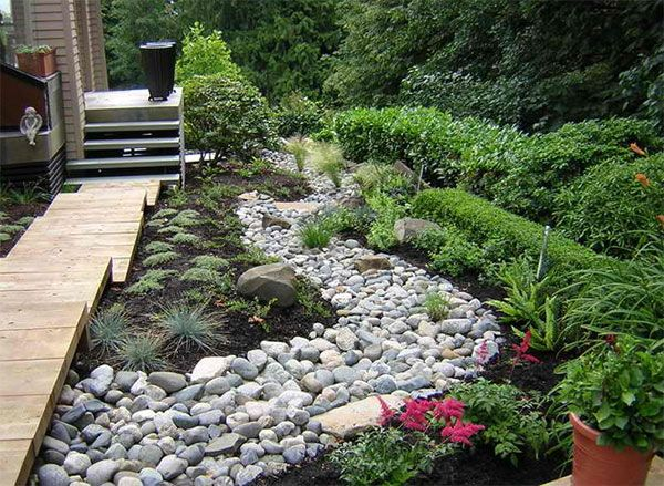 Tips On How To Landscape On A Hill Home Design Lover River Rock Landscaping Dry Garden Design Dry Creek Bed