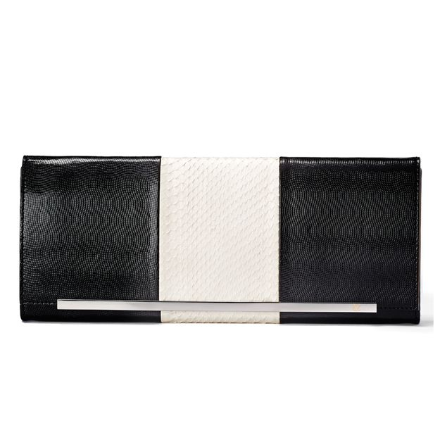 COOL CONTRAST:  BAGS | VINCE CAMUTO - Oversized black and white glimmer / fat snake clutch with metal strip detail.
