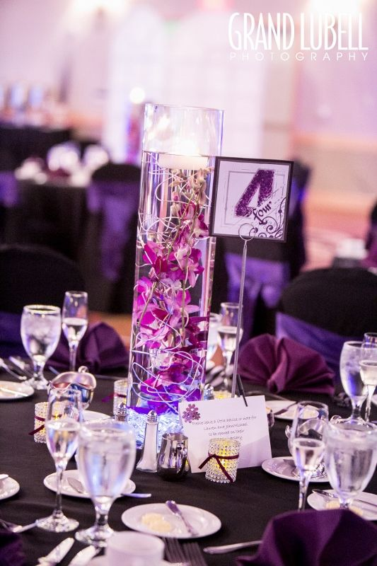Purple submerged dendrobium orchid centerpiece by