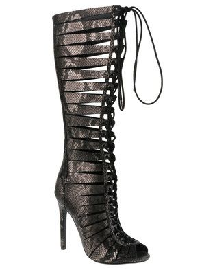 97742edbdca Be a fashion warrior in these Cryptic Leather Gladiator High Heels by Steve  Madden. In sultry black snake skin-like leather