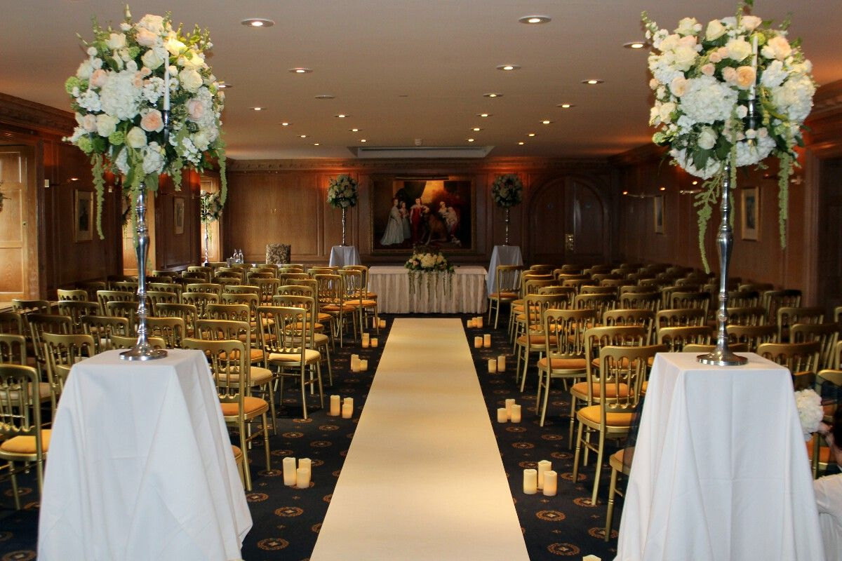 White Carpet Aisle Runner And Led Candles Decorating The Wedding Ceremony Room At Brocket Hall
