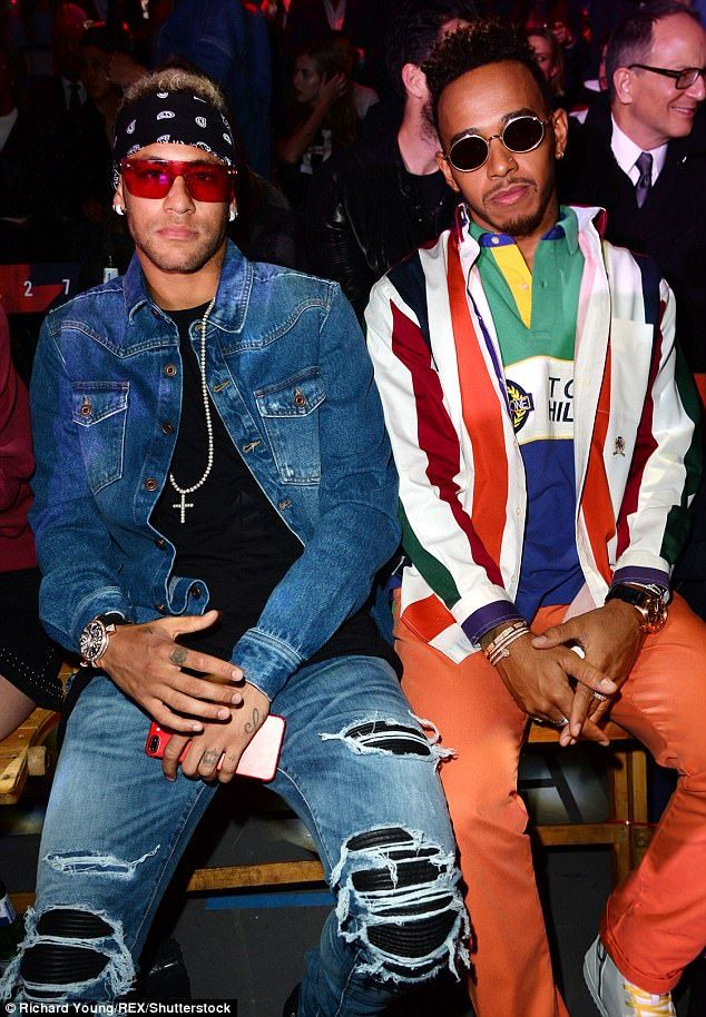 553217ad Lewis Hamilton (R) and Neymar continued their string of boys' nights out on  Tuesday, as they headed to the Tommy Hilfiger SS18 catwalk show
