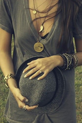 ok.  i like this.  The low cut V-Tee is cute, accented by a few simple chains....fedora - keeps it sassy