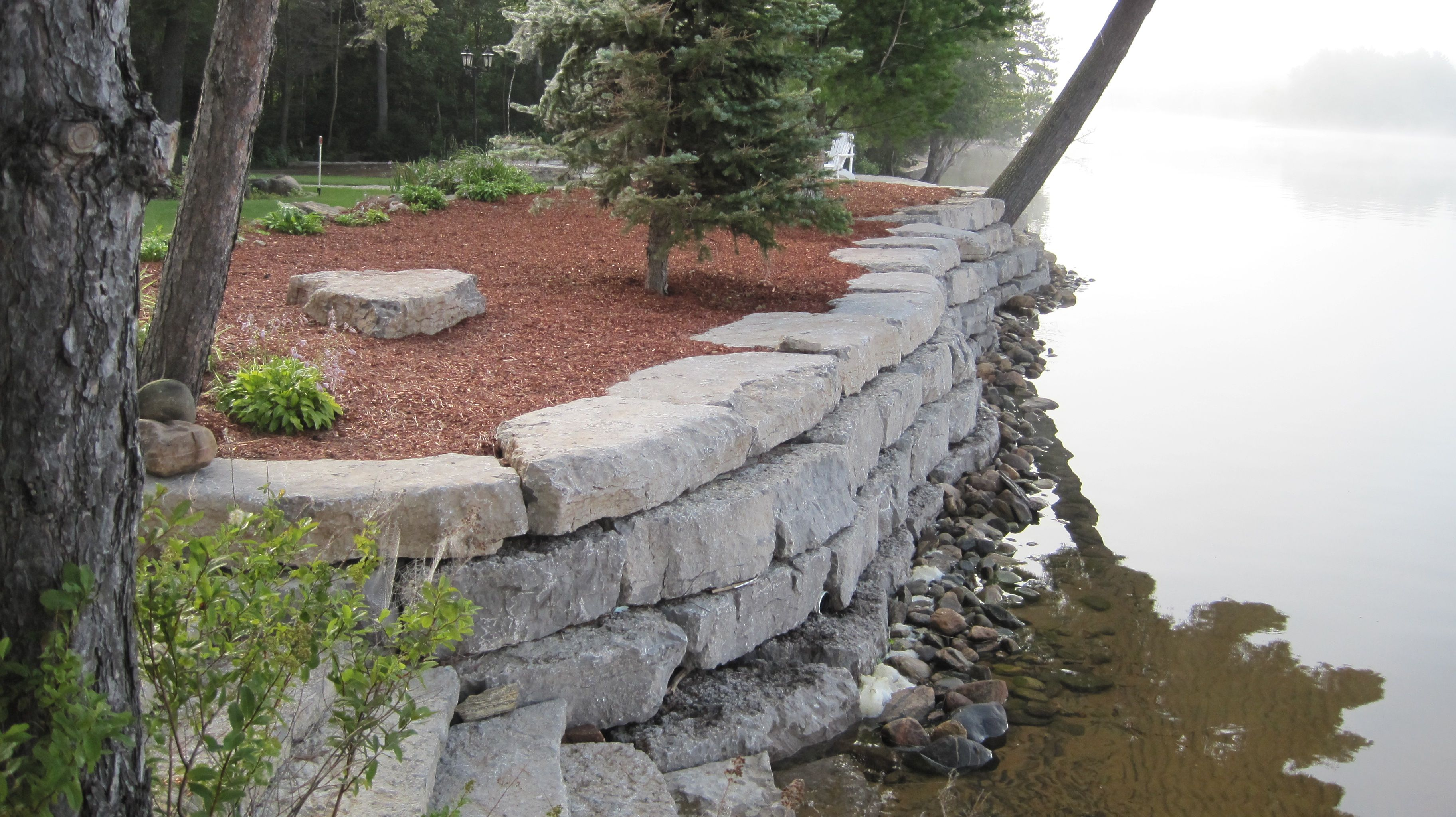 unbelievable curved gabion wall. BrightWoods Landscaping  Limestone Armour Stone Shoreline Retaining Wall