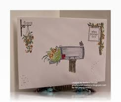 A picture of a mailbox in the mailbox. Great colors and design. Have to try this one.