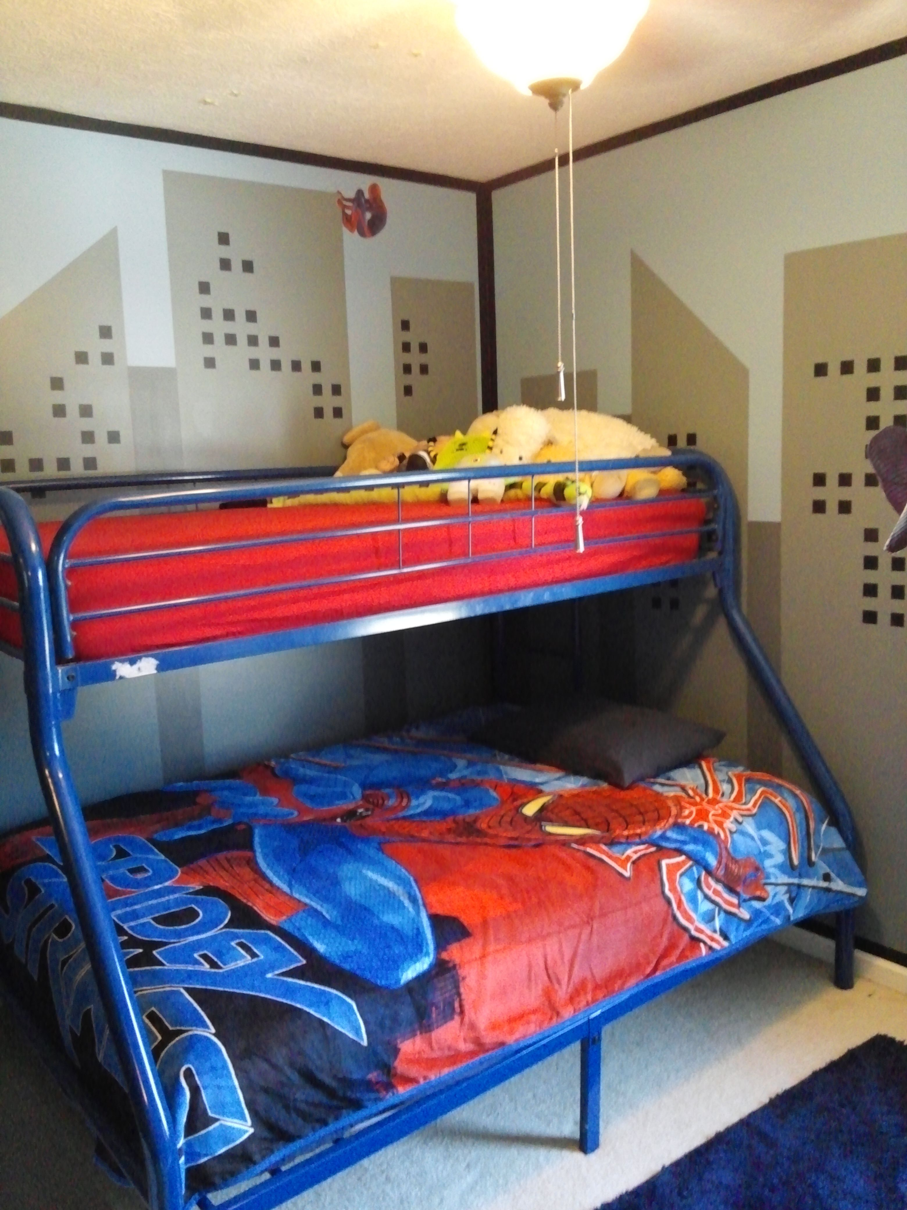 SpiderMan walls outlined to give comic book feel. Bed
