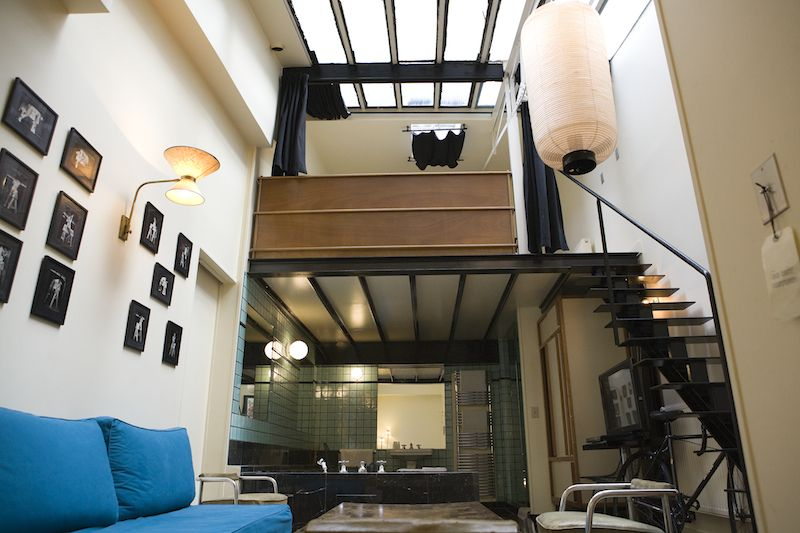 Stairs High Ceiling Bedroom Overlooking Living Area