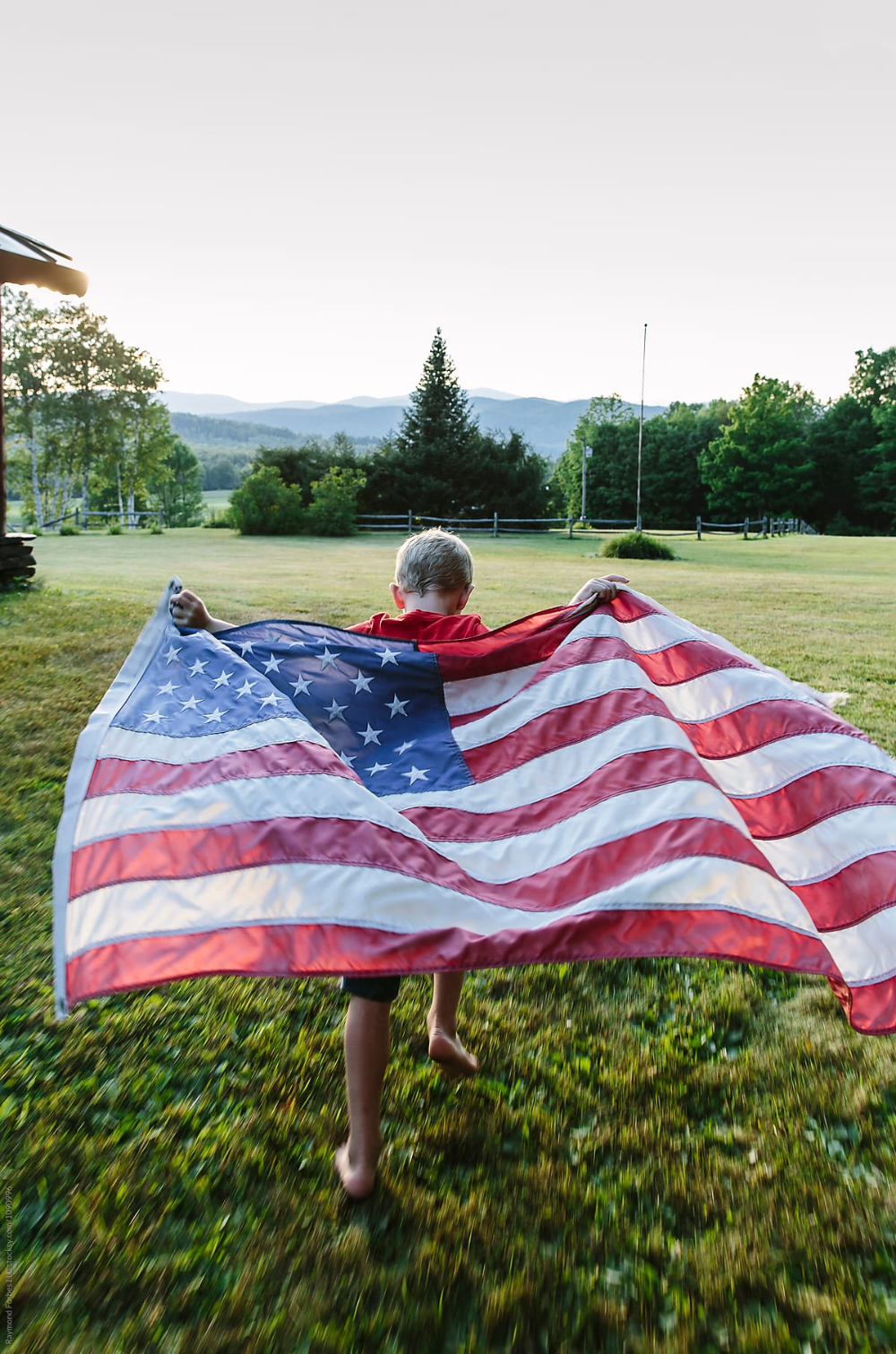 Child Running With American Flag In Beautiful Rural Landscapefamily Lifestyle Photography O In 2020 American Flag Photos Beautiful Landscape Photography American Flag