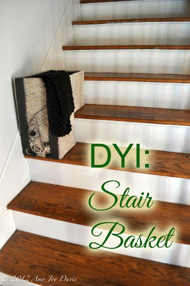 Confessions of The YankeeGirl: diy stair basket made with cardboard boxes and upholstery fabric.
