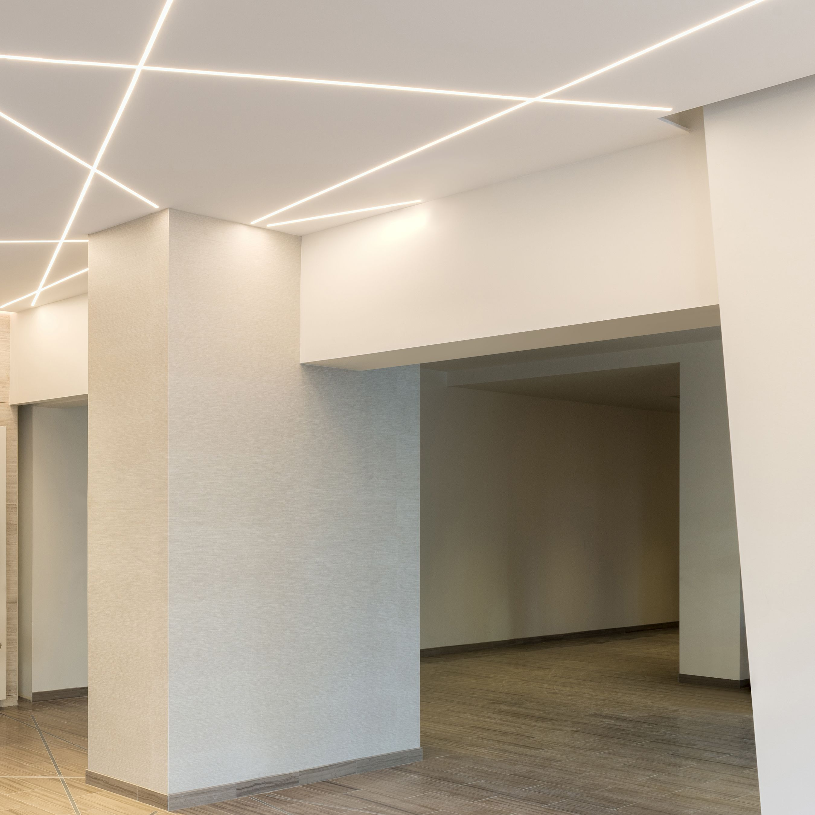 pure lighting stratus led. truline .5a creates glare-free architectural lighting accents within this commercial space | led pure stratus led