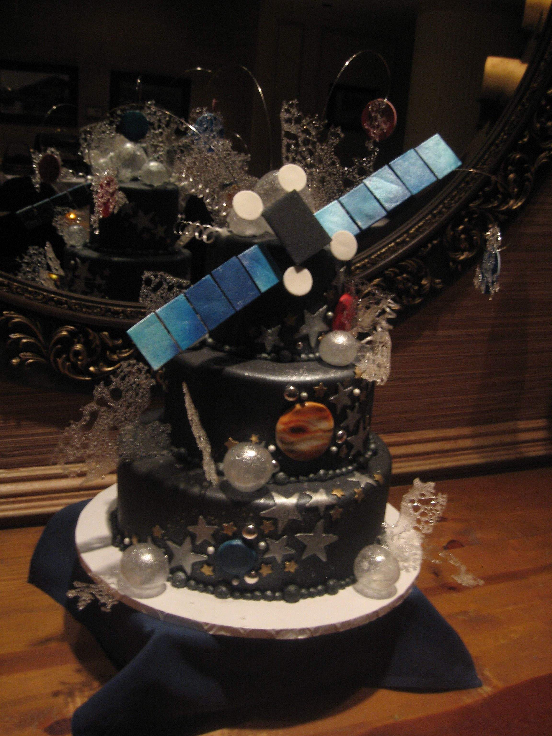 Outer Space Theme Cake With A Satellite On Top Sugar Work