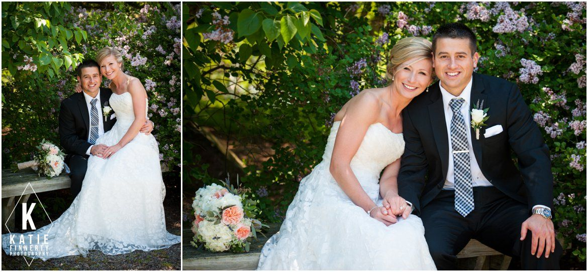 Bride and groom sitting on an old bench in front of lilacs at this summer wedding photographed by Katie Finnerty Photography http://katiefinnertyphotography.com/