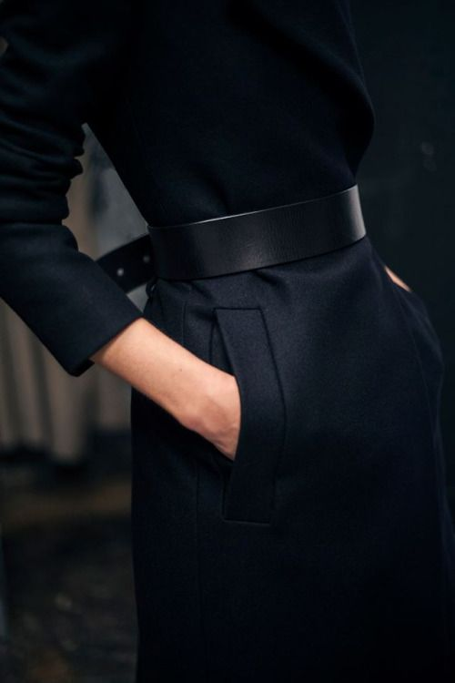Black wide belt with black top and trousers, or skirt, belted at the back